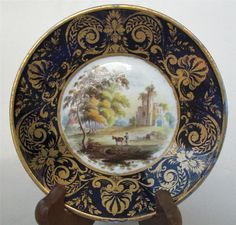 DERBY 19 TH CENTURY SAUCER. CENTRED WITH A PAINTING NEAR    INVERARY SCOTLAND.