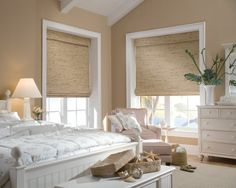 Master bedroom  and sitting room natural woven wood shade.. pair it with stationary panels :)