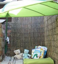An outdoor reading corner made from a bench seat, reed screens, and a sun shade (via little blossoms) Outdoor Nursery, Outdoor Baby, Outdoor Fun, Outdoor Living, Outdoor Reading Nooks, Reading Garden, Reading Areas, Reading Corners, Outdoor Learning Spaces