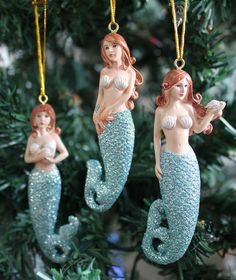 Beauty of the sea ornaments are fun and whimsical with blue glitter tails, and for anyone who loves mermaids. Nautical Christmas, Beach Christmas, Holiday Beach, Christmas Holiday, Paper Decorations, Christmas Decorations, Mermaid Ornament, Mermaid Art, Mermaid Sculpture