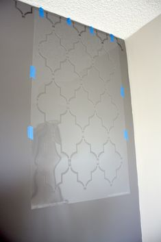 grey wall with valspar metalic glaze as the stencil paint!