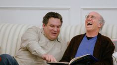 Jeff and Larry have fun reading Ted Danson's birthday present for him.  (The Freak Book)