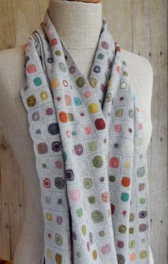 Hand crocheted pops of color on a light grey-taupe background. From Sophie Digard. 12 x 53 inches
