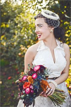 collared wedding dress on vintage inspired bride #vintage #bride #weddingchicks http://www.weddingchicks.com/2014/02/19/michigan-fall-favorites-wedding-inspiration/