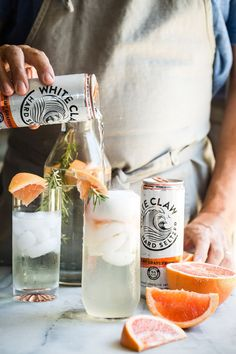 """Summer should be all about refreshing sparkling seltzer drinks like this White Claw Ruby Grapefruit Hard Seltzer, Prosecco and fresh rosemary. If I had to choose a """"hammock drink""""...this would be it!"""