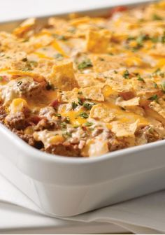 Tex-Mex Beef & Rice Casserole — Here's a ground beef and rice casserole with all the Tex-Mex flavor you enjoy—onions and peppers, tortilla chips, cilantro, and a blend of creamy cheeses. Add this easy recipe to your back-to-school menu.