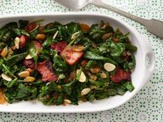 Baby Spinach with Almonds and Golden Raisins : Yes, both bacon and butter can be part of healthy recipes! Use just a small amount of each in this Spanish-inspired side dish, saving the butter for the very end so it has more impact.