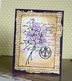 old book paper, distress ink, water (or distress stain OR Tea bag); page with   stamped flower colored in all stacked on each other to make a card