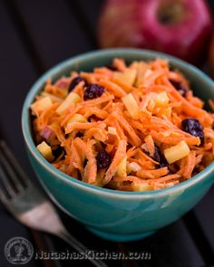 Quick Carrot & Apple Salad Recipe 4 medium carrots, coarsely grated 1 apple, diced ¾ cup craisins (dried cranberries) ¼ cup purple or sweet onion, finely diced For the Dressing: ½ cup mayonnaise (real mayo or vegenaise) 2 tsp lemon juice ½ Tbsp sugar ⅛ tsp sea salt, or to taste pinch of black pepper, freshly ground