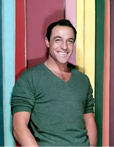 Love the way Gene Kelly wore his sweaters, it was always a v-neck with the sleeves rolled up and he cuffed his jeans 50 years before anyone else, so you could see his socks which he wore with loafers. Biddy Craft
