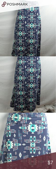 Blue Aztec Design Foldover Maxi Skirt By Lily Star This is a gorgeous maxi skirt from Lily Star that is dark blue with Aztec designs all over it.  The top folds over, and it is made of soft, comfortable cottony material.  This skirt has no flaws and is size medium.  #lilystar #maxiskirt #foldover #aztec #aztecdesigns #sizemedium Lily Star Skirts Maxi
