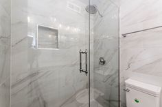 The bathrooms at Astor House feature all white designs with glass shower doors, large mirrors, rain shower heads, quartz countertops and white cabinetry. If you love the look of this shower, wait until you see the apartments and amenities! For more information and availability please visit our website at astorhouse.groupfox.com. #Chicago #apartments #shower #renovated #quartz #bathroomdesign #interiordesign Large Mirrors, Glass Shower Doors, Rain Shower, Quartz Countertops, Luxury Apartments, Shower Heads, Bathroom Ideas, Bathrooms, Chicago