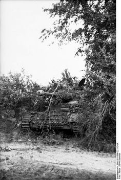 A very well camouflaged Panzer MK IV from an SS unit in Normandy. The MK IV was the most produced Panzer the Germans fielded during the war. It was an all around excellent medium tank.