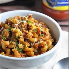 This delicious chili mac and cheese with ground beef, diced tomatoes, rich tomato sauce, chili beans and spices is cooked all in one pot--including the macaroni!