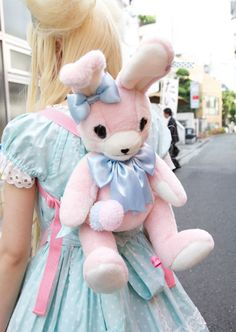 He is holding a little pompom icecream cone! <3 Bag is by Angelic Pretty. :3