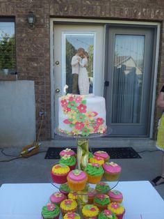 Yellow pink green mini wedding cake and cupcakes