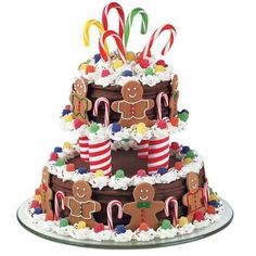 A Very Merry Go Round Cake -  Complete your holiday party with A Very Merry-Go-Round. Gingerbread boy cookies border each of the two tiers of this cake. Seasonal treats, such as spice drops and candy canes, complete the decorations.