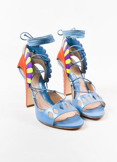 "Paula Cademartori blue ""Lotus"" sandals featuring wrap around ties at ankle. Designed with a hot pink cut out vamp and heels. Purple suede and yellow patent leather gladiator style fringe adorns the an"