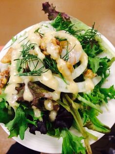 Arugula, shaved fennel, candied walnuts, champagne poached shrimp with roasted pear vinaigrette