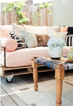 Like this pallet daybed idea for outside lounge area