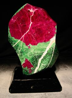Zoisite / Ruby Object    21 x 17 x 34 cm    with a natural crust on the rear side.  Size of the ruby: 18 x 14 x 8.5 cm.