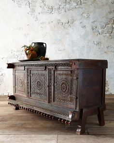 "Antique carved damachiya chest is over 100 years old and wears its original hand-painted finish. Traditionally, a damachiya would have stored dowry items for a bride and valuables in the home thereafter. Handcrafted of wood. 48""W x 15""D x 34""T. Made in India. Each will vary.