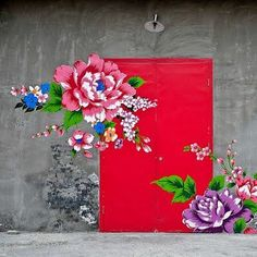 Flowers on Red Door...art has purpose and it can be everywhere we dare to create it.