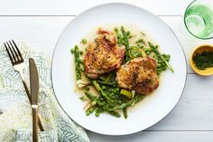Gently cooked in olive oil, delectably tender leeks melt like butter over fennel-scented chicken thighs and snappy green vegetables in this easy spring braise.