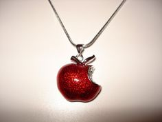 Apple Necklace. Sterling Silver Apple Pendant with Red Enamel and Swarovski Crystal Accents. Pendant is sterling silver plated. The pendant measures 19