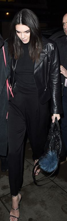 Who made  Kendall Jenner's black leather jacket, handbag, key chain, and silver sandals?