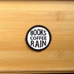 "Books Coffee Rain Patch - Iron or Sew On - 2"" - Embroidered Circle Appliqué - Black White - Cozy Nerd Phrase Hat Bag Accessory Handmade USA by NoffHouseShop on Etsy https://www.etsy.com/listing/248895113/books-coffee-rain-patch-iron-or-sew-on-2"
