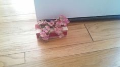 Wrapped door stopper. All you need is a glue gun a brick some extra fabric and ribbon