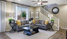 This open, inviting, Laveen, AZ, great room certainly lives up to its name!   Citrine plan   Seasons Collection by Richmond American