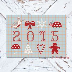 Greeting Card featuring warmhearting Christmas items for the year 2015.  Designed by Artibonita