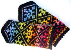 Rainbow wool mittens Hand knitted warm mittens Winter gloves Rainbow patterned mittens Rainbow color tinted ornament on a black background