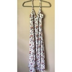 """Boho Maxi This tiered maxi dress is hitting all the right stops  The pattern is a must and the fit is super comfortable. It is in brand new condition with no flaws. It is a cross cross back. Would fit anyone shorter than 5'7"""". If you have any other questions just let me know  Forever 21 Dresses Maxi"""