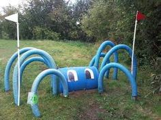 Spider horse trail obstacle :) Looks like all you need is half a barrel and noodles