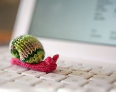 little snail. // I shall learn to knit, and I shall make you this pointless tiny snail, @Janielle Kastner.