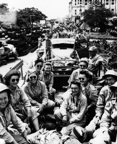 U.S. Army nurses ride through the streets of Manila in February 1945 on their way to take over for army nurse POWs recently liberated at Santo Tomas Internment Camp. The Japanese imprisoned 78 military nurses and thousands of U.S. civilian women and children in the Philippines during World War II.