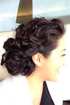 A romantic updo that is so easy anyone can do it. Check this hairstyle out if you are a romantic bride or you are simply a curls lover.