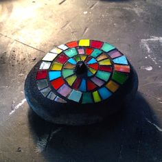 Mosaic on rock by Anne Marie Price