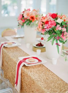 love gold fabric w/ red plate and ribbon on top of napkin
