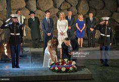 US President Donald Trump (C-R) and First Lady Melania Trump (C-L) lay a wreath during a visit to the Yad Vashem Holocaust Memorial museum, commemorating the six million Jews killed by the Nazis during World War II, on May 23, 2017, in Jerusalem. /