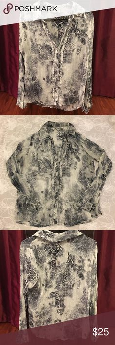 """Chico's gray & white sheer button blouse Sz 0 Gorgeous blouse! LIKE NEW condition!   This Chico's Gray and White Sheer Blouse features sheer wrinkle texture, a soft ruffled front, and it is cut longer in back.  All Buttons intact. Buttons at the end of the sleeves. 100% polyester No rips, tears, holes or stains.  Size 0  Approximate measurements laid flat- Width (Armpit to Armpit):  21"""" Length (back of collar to hem):  25.5""""   (23.5"""" length in the front) From a smoke-free & pet-free home…"""