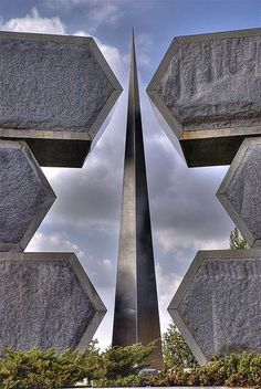 The Partisan Memorial in Jerusalem honors the 6 million Jews that passed away during the Holocaust. The 6 surrounding blocks create the Star of David. The sharp object in the center represents the millions of people that fought and died during the horrible time.
