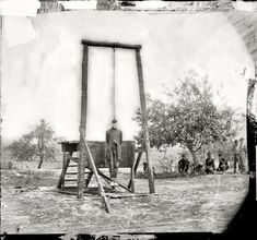 """June 20, 1864. Petersburg, Virginia (vicinity) """"The execution of Sergeant William Johnson, Negro soldier, at Jordan's farm. Hanged for Desertion and an Attempt to Outrage the Person of a Young Lady at the New-Kent Courthouse."""" (Supposedly he insulted a white woman and was made an example of to other soldiers who might be considering desertion; the outcome was not what the Federal Army had hoped for.) Wet plate glass negative by Timothy H. O'Sullivan. View full size."""