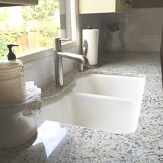 White Dallas granite with white subway tile- kitchen remodel