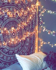 Tapestry and Polaroids with twinkle lights = room goals ✨