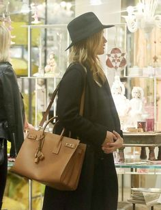 Supermodel Rosie Huntington-Whiteley was seen holding her pregnant belly while shopping at ABC Carpet