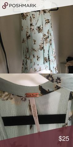 Free People tree swing dress Green with small floral print Higher in the front V neck choker neckline Pockets Free People Dresses Mini